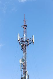 foto of antenna  - Antenna transmission tower with clear blue sky - JPG
