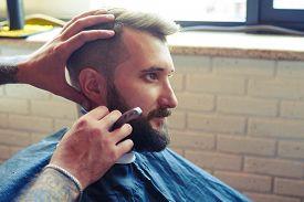 stock photo of barber razor  - portrait of handsome man in barbershop - JPG