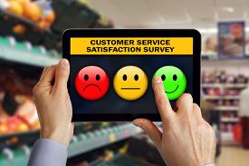 picture of emoticon  - Digital tablet in shop with customer rating a service satisfaction questionnaire survey choosing a happy smiley emoticon - JPG