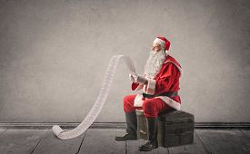 foto of letters to santa claus  - Santa Claus reading a letter - JPG
