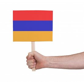 image of armenia  - Hand holding small card isolated on white  - JPG