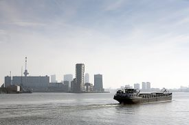 picture of barge  - Barge on the river Meuse in Rotterdam - JPG