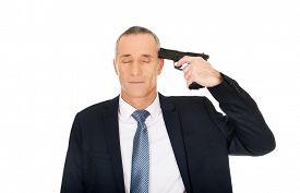 picture of handgun  - Portrait of a man with handgun near head - JPG
