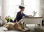 Woman Petting Golden Retriever Dog poster