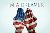 the hands of a man put together patterned as the flag of the United States and the text I am a dream poster