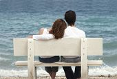 pic of couple sitting beach  - couple on bench - JPG