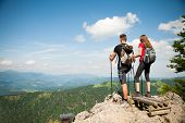 Active Beautiful Young Couple Hiking Ina Nature Climbing Hill Or Mountain - Man And Woman Trekking poster