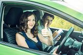 Instructor And Female Student Driving Showing Thumb Up. Woman Passed The Exam In Driving School. poster