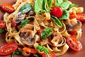 Home Made Vegan Pasta With Mushrooms, Tomatoes, Basil, Peppers And Aubergines - Served On Plate At W poster