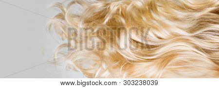 poster of Hair. Beautiful healthy long curly blonde hair close-up texture. Dyed Wavy white hair background, co