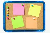 picture of bulletin board  - bulletin board and multi colored stickies attached with push pins - JPG