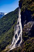 Geiranger fjord, waterfall Seven Sisters. Beautiful Nature Norway natural landscape. poster