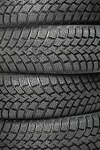 foto of four-wheel drive  - Background of four wheel new black tyres for winter car driving - JPG