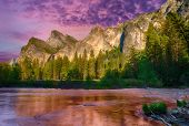 Granite cliffs reflecting in Merced river during vivid dusk, Yosemite National Park. California, USA poster