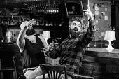 Hipster Brutal Bearded Man Drinking Alcohol With Friend At Bar Counter. Men Drunk Relaxing At Pub Ha poster
