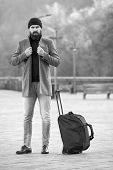 Man Bearded Hipster Travel With Big Luggage Bag Wait For Taxi Bring Him To Hotel. Travel Tips. Trave poster