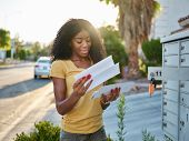 african american woman checking mail in las vegas community poster