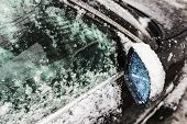 Car Side-view Mirror And Car Window Covered With Ice And Snow, Window Cleaning, Bad Weather, Snow An poster