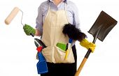 pic of spring-cleaning  - A woman with various spring cleaning and redecorating items including a paint brushes garden tools cleaning chemicals and items - JPG