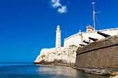 stock photo of el morro castle  - The famous castle and lighthouse of El Morro  in the bay of Havana - JPG