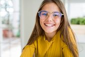 Beautiful young girl kid wearing glasses with a happy and cool smile on face. Lucky person. poster