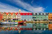 Torshawn city, the capital of The Faroe Islands, Denmark. Vestaravag harbor in Torshavn with its boa poster