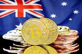 Bitcoins On The Background Of The Flag Australia. Bitcoins On The Background Of The Australia Flag.  poster
