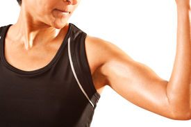 foto of body builder  - An athletic Asian Indian woman clenches her bicep - JPG