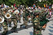 KUALA LUMPUR - AUGUST 31: Drums and brass band from the Malaysian Armed Forces march on the city str