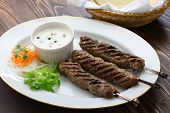stock photo of flat-bread  - ground lamb kebab with flat bread - JPG
