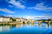 Ponte Alle Grazie Bridge On Arno River, Sunset Landscape. Florence Or Firenze, Italy.