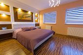 foto of master bedroom  - Modern master bedroom interior with picture of shipwreck on the wall  - JPG