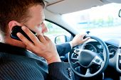 pic of pep talk  - male businessman talking on a cell phone while driving - JPG