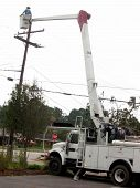 pic of boom-truck  - utility workers on boom fixing power pole  - JPG