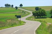 stock photo of curvaceous  - Curvaceous country road on the Swabian Alb Baden - JPG