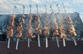 stock photo of spit-roast  - Roasted meat of young pigs on a spit - JPG
