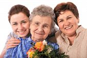 foto of mother daughter  - mother receives a bunch of flower from her family - JPG