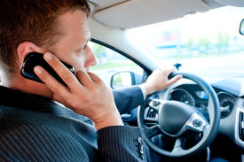 stock photo of pep talk  - male businessman talking on a cell phone while driving - JPG
