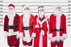 picture of lineup  - People in Santa costume standing side by side against police lineup - JPG
