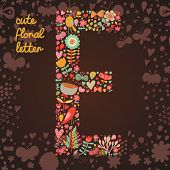 The letter E. Bright floral element of colorful alphabet made from birds, flowers, petals, hearts an