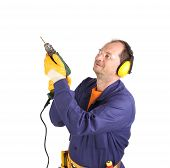 picture of muff  - Worker in ear muffs and glasses with drill - JPG