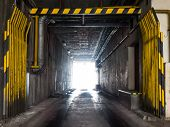 stock photo of underpass  - Industrial underpass with entrance gate and dark tunnel