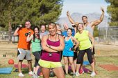 picture of boot camp  - Group of happy people in boot camp fitness class - JPG