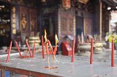 picture of malacca  - Burning Red Candles as Offerings to Chinese Gods at Chinese Temple in Malacca Malaysia  - JPG