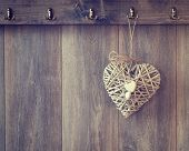 picture of hook  - Rustic heart decoration hanging from hook on wood panel wall  - JPG