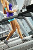 picture of treadmill  - Image of fitness girl running on treadmill - JPG