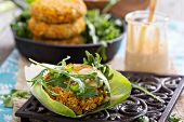 stock photo of veggie burger  - Vegan burgers with sweet potato served with arugula and peanut sauce - JPG