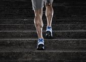 stock photo of calf  - Close up of young man running up th stairs - JPG