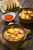stock photo of hungarian  - Two bowls of the Hungarian dish called Paprikas Krumpli  - JPG