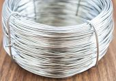 stock photo of coiled  - photo background coil of metal wire closeup